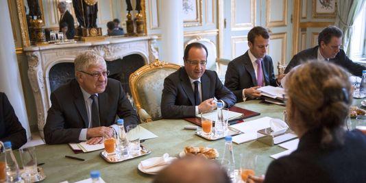 Les 20 mesures le 21 mars à l'Élysée (Photo Fred Dufour/AFP).